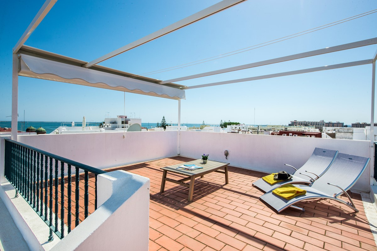 Upper Terrace with retractable shades and sun loungers, a perfect place to relax