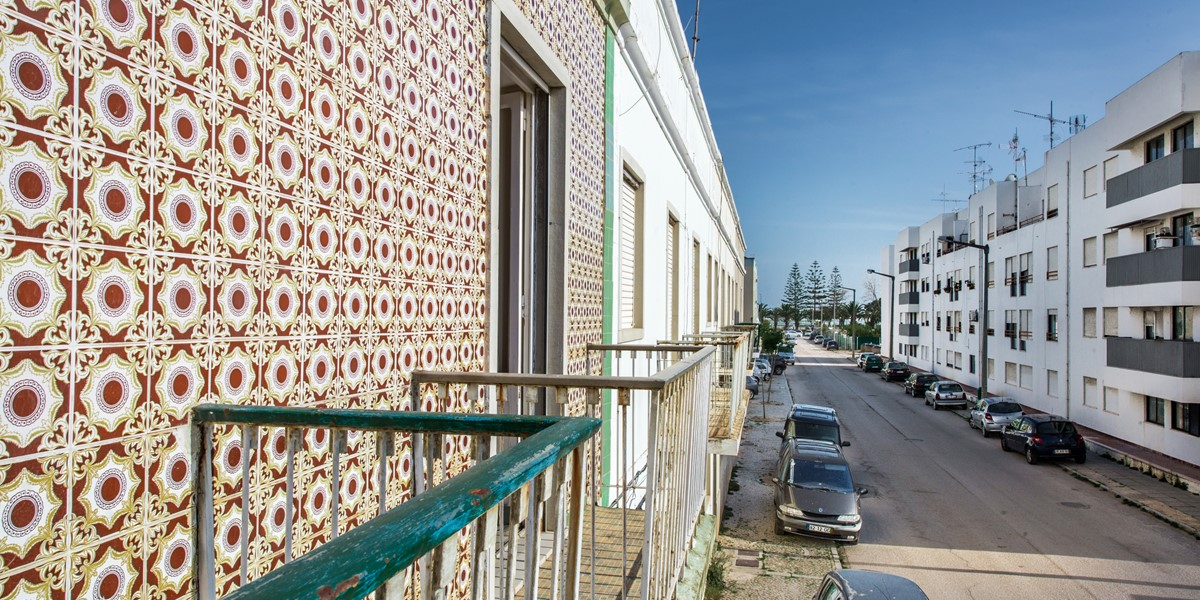 Traditional wall tiles and Juliet balconies