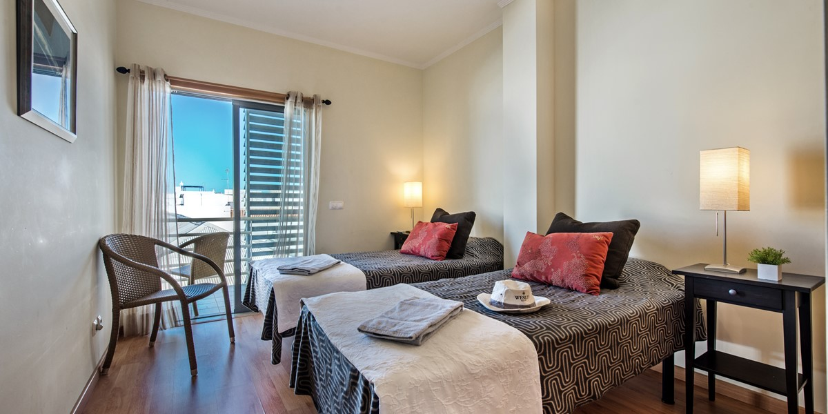 Second bedroom with twin beds overlooking Olhao