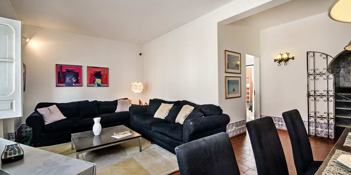 The warm and inviting sofa at our 3 bedroom townhouse by MarsAlgarve