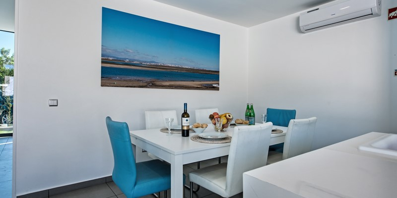 A dining area right by the galley style kitchen