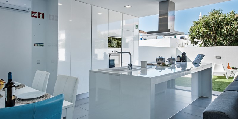 The kitchen is chic modern and functional in every way