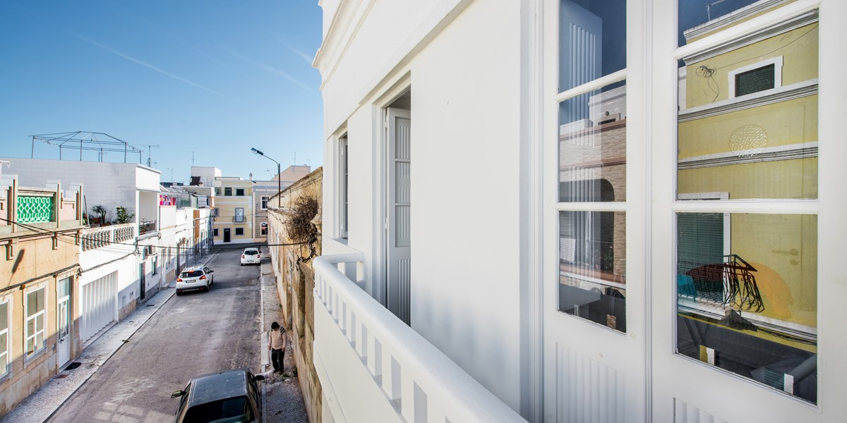 The balcony above the front door at this 3 bedroom townhouse