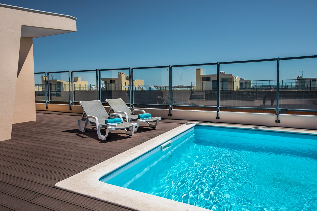 Loungers around the roof top pool with 360 views.