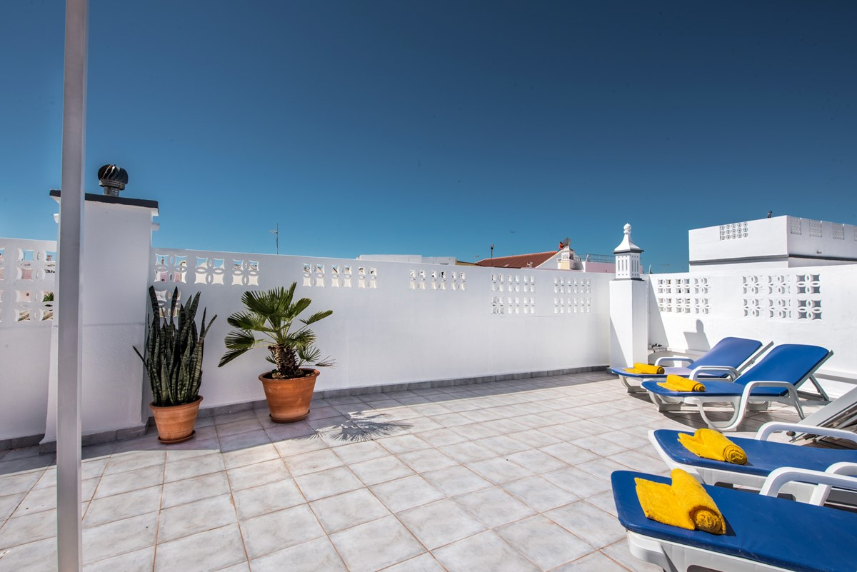 Sun loungers on the roof terrace at Casa Agave