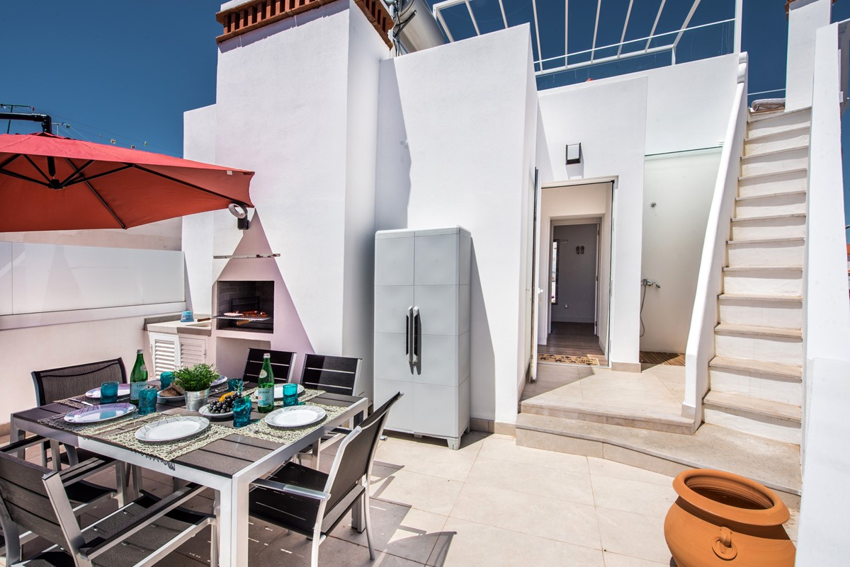 Steps up again to the private roof terrace with roof top views of the city