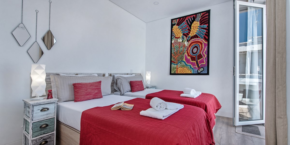 Large bedroom with single beds and a private terrace