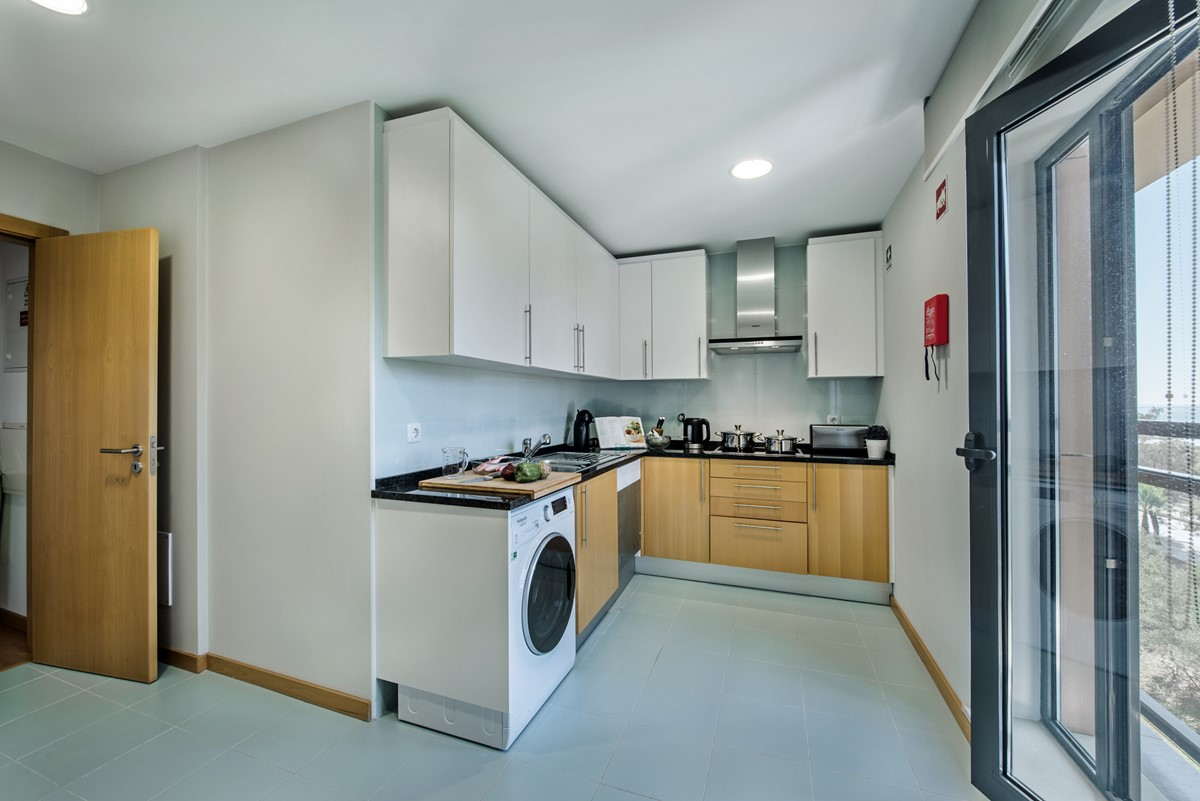 Well Equipped Kitchen at The Three Bedroom Apartment