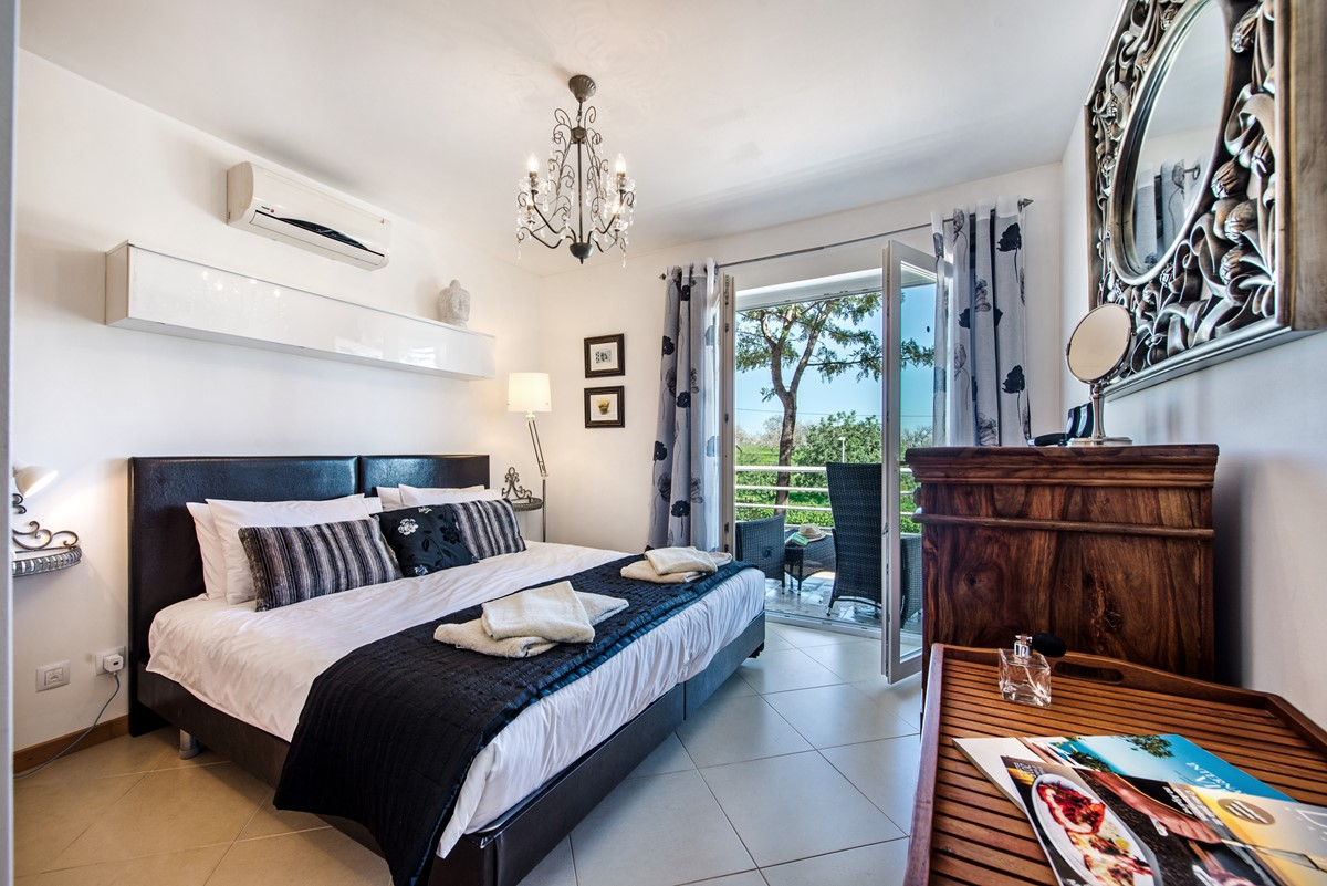 Our Opulent Bedroom with a Kingsize bed
