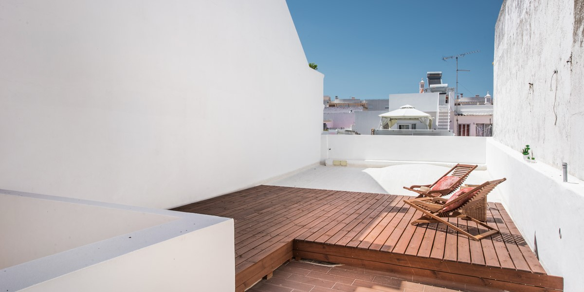 A Decked Area On The Roof Terrace To Enjoy The Sunshine
