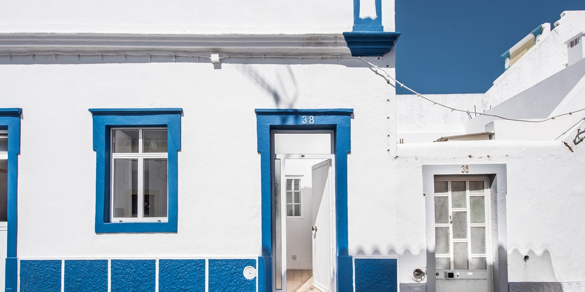 A Pretty Blue And White Facade On This Traditional 2 Bedroom Cottage