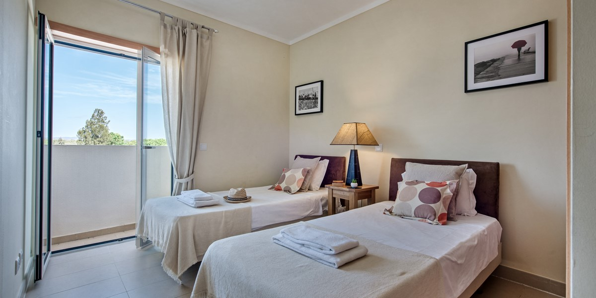 Comfy Twin Single Beds With A Lovely Balcony