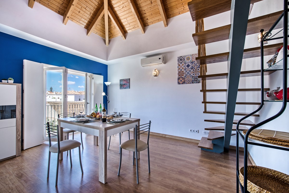 The dining table on the lower part of the split level living