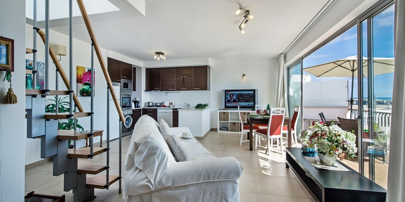 The open plan living space is designed to take full advantage of the sea view