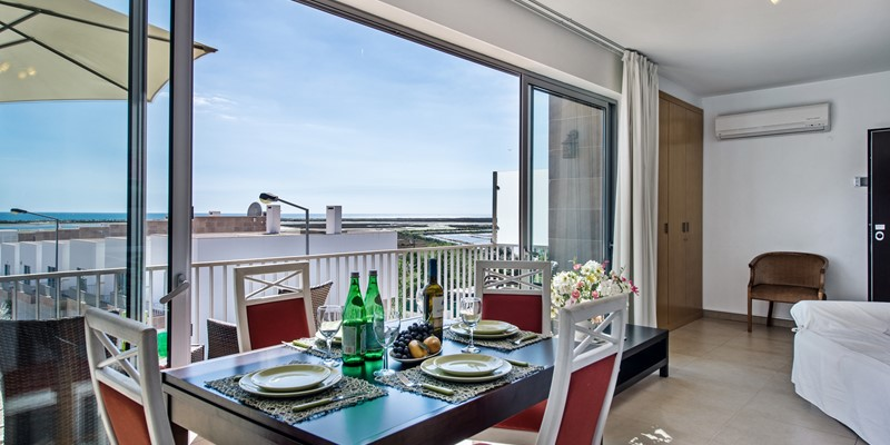 The huge french sliding windows add to the space by incorporating the balcony
